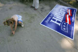 Thea Steinbach (cq), 4, of Ankeny, IA., plays with hay next to a sign for Hillary Clinton at a...