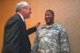 Gov. Bill Ritter (cq) welcomes home 1st Sgt. James Logan (cq) a member of the 169th Fires Brigade...