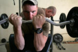 04/06/2005 Iraq-Austin Wilmarth, 22, Harrisburg, Penn., lifts weights in the Morale Wellness and...