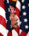 Lester Hunt (cq), a member of the Patriot Guard Riders, stands  to welcome home members of the...