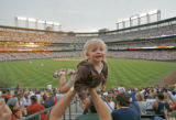 129 Katherine Bryan, 2, gets a birds eye view of her first professional baseball game as her...