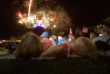 374 Michael Vandersanden, CQ, 5, (rt) of Aurora, watches fireworks with his mother (left)...