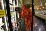 Wanda Kelly, cq, of Denver,  reaches down for some milk, Tuesday July 3, 2007 at Sunflower Market...