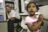(DENVER, Colo., April 6, 2005)  Cindy Martinez (cq) (left) picks up her granddaughter Jayanti...
