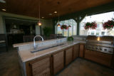 An outdoor kitchen in the Trade Winds which is on of 5 homes a part of the Parade of Homes in...