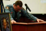 (CASTLE ROCK, Colo., Apr. 20, 2005) Douglas County Sheriff's Deputy Scott Daily (cq) becomes...