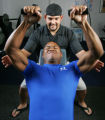 For our midpoint Rocky Fitness Challengers update trainer Jason Spurlock (cq), top, with the Body...