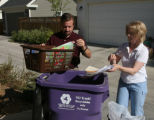 Michael Kearns, left, and his wife, Diana Kearns (cq), put recyclables into the a container,...