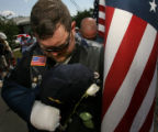 Tom Meiers (cq), a member of the Patriot Guard Riders bows his head as a prayer for Navy Seal...
