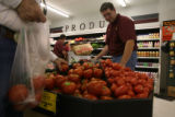 DLM0841  Zach Deal stocks tomatoes at the Edwards Price Right Market in Fort Morgan, Colo. Wed.,...