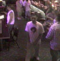 Denver Police believe the man, at left in the white t-shirt and shown in a surveillance video at a...
