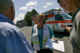 Swedish Medical Center Public Information Officer Julie Lonborg (cq) talks to members of the press...