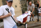 MJM077  Allie Vining-Barnes, 4, is carried out of Children's Hospital by her father, Casey Barnes...