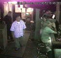 Denver Police believe the man in the checked shirt, shown in a surveillance video at a Denver...
