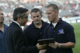 Rapids Managing Director Jeff Plush presents a plaque to Iraq War Veterans Sergeant Gary Boggs...