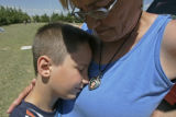382 Kathie Lords, CQ, 56,  and her grandson, Damien Kenneth Lords, comfor each other while he...