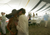 Martina Dawes (cq), of Canon City, left, kisses her boyfriend Steven Wiskow, of Denver, right, at...