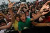 "Fans sing along to the music of ""CIRCA SURVIVE"" at this year's Warped Tour. The Vans..."