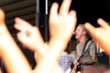 "Ryan Key (cq), the guitarist and vocalist of ""Yellowcard"" plays for the fans at this..."