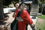 (Denver shot on 4/21/05) Miguel Villagrana (CQ-Miguel Villagrana) ,17,(right) is congratuated by...