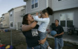 (Colorado Springs, Co} shot on 4/12/05})  Lisa Dennis (cq) holds her daughter Charly, (cq) 2 as...