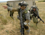 A combined squad of Soliders from Bulgaria, Romania and U.S. Army , Europe assault a suspected...