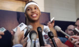 (DENVER, Colo., April 21, 2005)  Carmelo Anthony speaks with the media after practice Thursday...