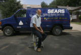Edward R. Humbert (cq) is a Sears Service Specialist at his home at 120 N. Estes St. in front of...
