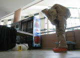 1162 SSG. Nick Saltros, of the 8th Civil Support Team, Colorado National Guard, examines a...