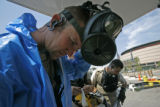 1274 SSG. Joe Ziser, left, of the 8th Civil Support Team, Colorado National Guard, prepares to...