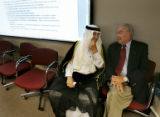Sheikh Mohammed Baker Al Suhail (cq), left, a Baghdad city council member, talks with Jack Houser...