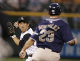 0399 Colorado Rockies Kazuo Matsui turns a double play knocking out Padres Arian Gonzales at...
