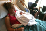 Connie Honstein(cq) holds her daughter Halle (cq) at the new Platte Valley Medical Center in...
