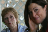Billie McBride (cq) , left, listens with Denise Perry-Olson as playwright Jeffrey Neuman talks of...