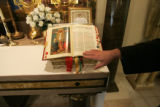 0060 Father Joseph Hearty, CQ, touches the Roman Missal that is used at every Mass in Latin at the...
