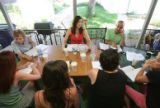 Billie McBride (cq) far left with stripe shirt hosted a first read through of a play in the...