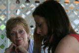 Billie McBride (cq), left, listens intently to Denise Peerry-Olson (cq) read her lines as she...