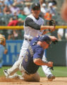 Rockies short stop Kazuo Matsui turns a double play getting out the Padres Kevin Kouzmanoff during...