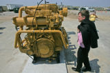 Denver Mayor John Hickenlooper gets a closer look at a engine generator that will power a new...