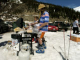 (ARAPAHOE BASIN, Colo., April 7, 2005) Joe Casselberry (cq), of Dillon, cooks some food in the...