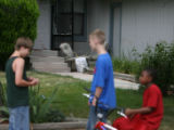 Neighborhood kids, (from left) Alex Biasizzo, 12, Dylin Mandel, 12 and Randy Canister, 12,  hang...