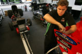 MJM285  Body specialist, Matt Dillanhunty (cq) of the John Force Castrol Racing Team works on the...
