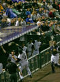 Rockies  first baseman Todd Helton leans into the dugout for the second out of the top of the...