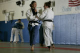 Grace Ohashi, 18, left,  spars with teammate Anna Palmer (CQ), 20,  right, during practice at the...