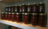 Jars of sauce line the shelves the Epicurean Culinary Group headquarters, Friday morning, July 13,...