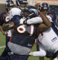 DLM3134  Defensive tackle Gerard Warren tries to muscle his way around a blocker during the...