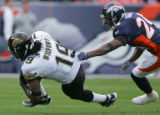 Champ Bailey drags Ernest Wilford down by his jersey in the first quarter of the Denver Broncos...