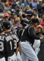 Colorado Rockies' Matt Holliday makes is way back to the dugout after his solo home run to kick...
