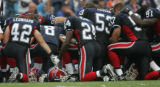 JOE1102 - Buffalo Bills players pray as their teammate Kevin Everett was attended to by medical...