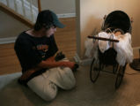 At Kayla DeMars home good friend, Adam Wooley (cq) sits in the living room in Arvada, Colo. on...